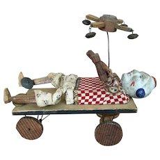 Antique papier mache clown pull-toy
