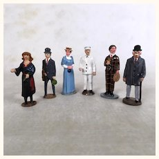 Six enameled cast metal miniature train figures