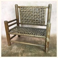 Vintage wooden and woven rattan doll sized bench