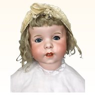 Antique French Bisque character doll with lovely glowing bisque