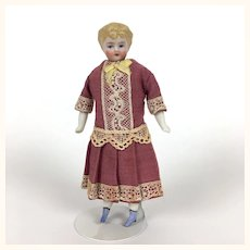 Miniature dollhouse china head lady with blue boots and fancy dress