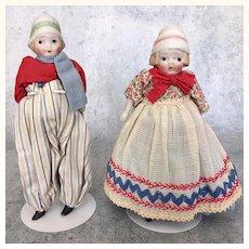 Vintage pair of bisque dolls in original costumes