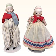 Vintage pair of bisque dolls in original costumes