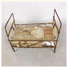 Antique miniature dollhouse bed