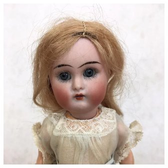 Miniature bisque flapper girl, Kammer and Reinhardt in mint condition, original clothing
