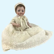 Antique all bisque baby with sleep eyes