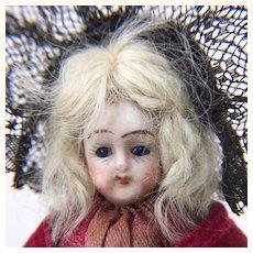 Antique tiny bisque lady in original clothing