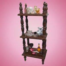 Vintage dollhouse etagére filled with miniature household decor