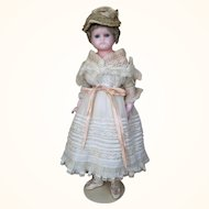 Antique German reinforced wax doll with lovely original clothing