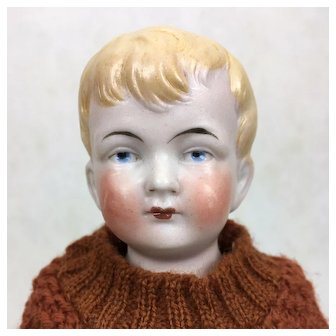 Antique all bisque blonde boy doll in knitted costume