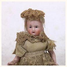 Antique all bisque miniature dollhouse doll