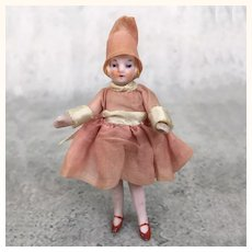 Miniature all bisque dollhouse girl in great clothing