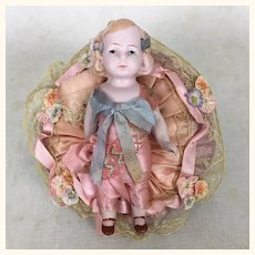 "Vintage 5"" German all bisque doll on pincushion or pillow"