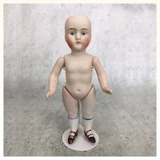All bisque miniature doll model 130 needs wig and clothing