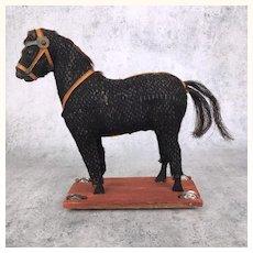 Antique burlap covered horse pull toy