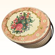 Vintage oval tin in lovely colors and floral top