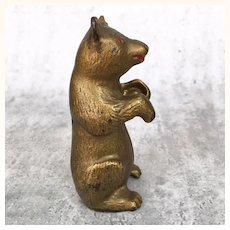 Antique gold painted cast iron begging bear still bank