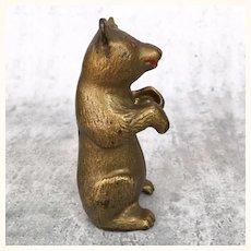 Antique gold painted cast iron bear animal still bank