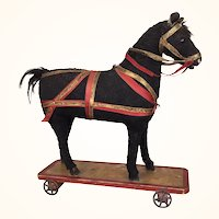 Antique toy horse on wheels pull toy