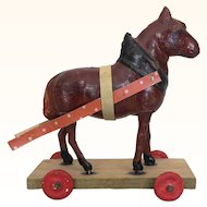 Antique tiny papier mache horse on wheels