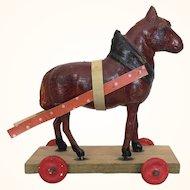 Antique tiny papier mache horse on wheels