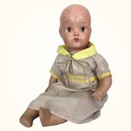 Vintage early composition mama doll with toddler legs