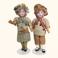 Antique pair of miniature German bisque head dolls