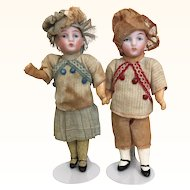 Antique pair of miniature German bisque head dolls
