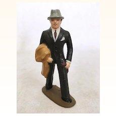 Vintage cast metal figure, dapper business man in grey fedora