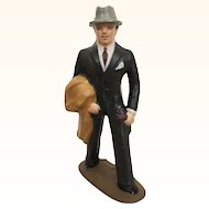 Vintage cast metal figure, dapper business man in grey fedora