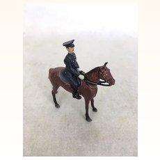 Vintage Britains miniature policeman on horse