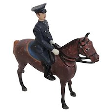 Vintage Britains miniature policeman on horse