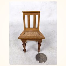 Old Miniature dollhouse chair with cane seat