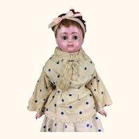 Antique wax over papier mache doll in polka dot dress