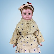 Antique wax over papier mache doll in polka dot dress