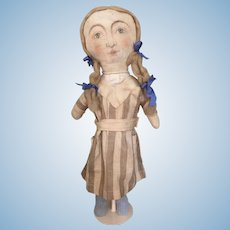 Artist cloth doll with painted face and antique dress