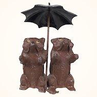 Vintage German miniature metal bears sitting under umbrella