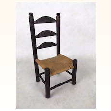 Old and very well made doll's chair with woven rope seat