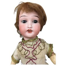 Antique German Bisque head doll with wood body