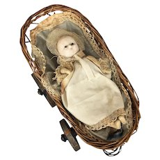 Antique wax over doll in basket