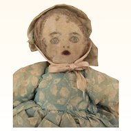 Handmade cloth doll with surprised expression