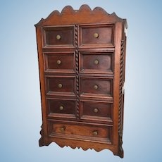 Antique miniature stained wood cabinet with nine drawers