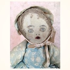 Antique handmade cloth doll with unusual expression