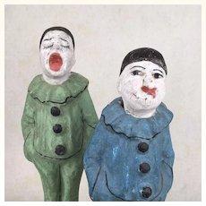 Antique pair of papier mache clowns