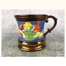 Antique child sized copper luster mug with brilliant colors