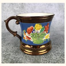 Antique child sized copper luster mug with brilliant colored glazes