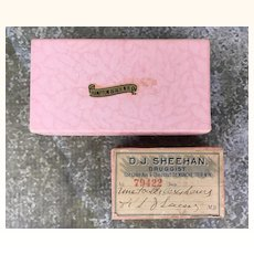 Two vintage pink boxes full of beads