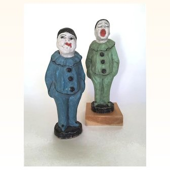 Antique pair of papier mache clowns