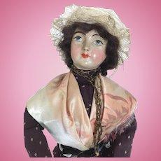 Papier mache lady doll in regional costume