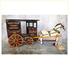 Antique wooden toy milk cart and horse